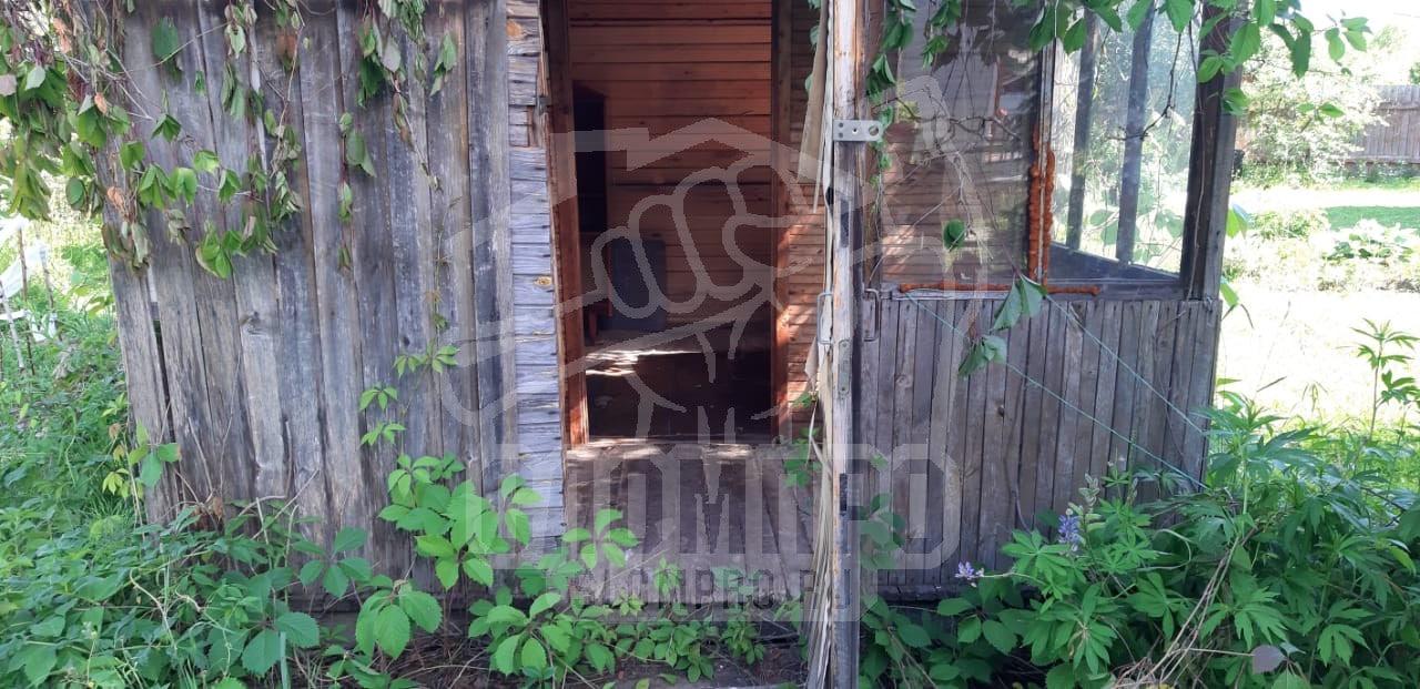 Фотография входа в садовый домик